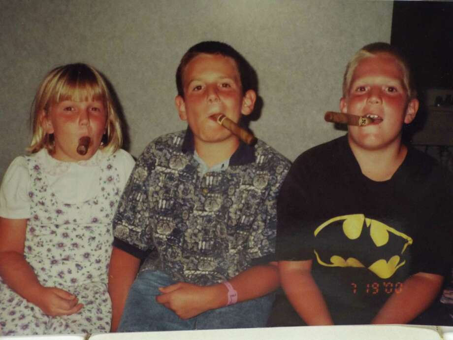 In the summer of 2000, the Heberling kids, Lauren, 7, Daniel, 9 and Andrew, 11, celebrated the family s move from Anaheim, Calif., to Texas with chocolate cigars from See s Candies. Photo: Heberling, Reader Submission