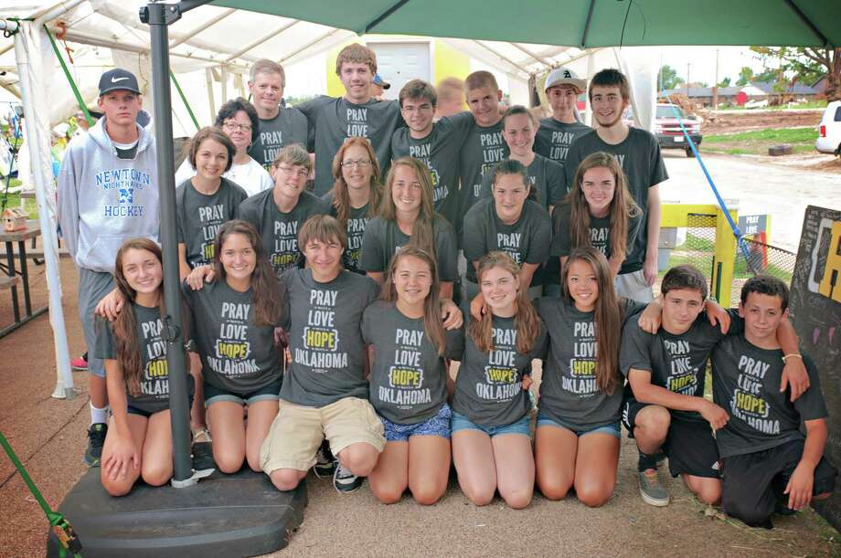 BenâÄôs Lighthouse workcampers posing in t-shirts that support the healing in Oklahoma after the three tornadoes in May.  The teens from Newtown met with families of the children killed and shared tears and hugs as each community supported the other. Photo: Contributed Photo / The News-Times Contributed