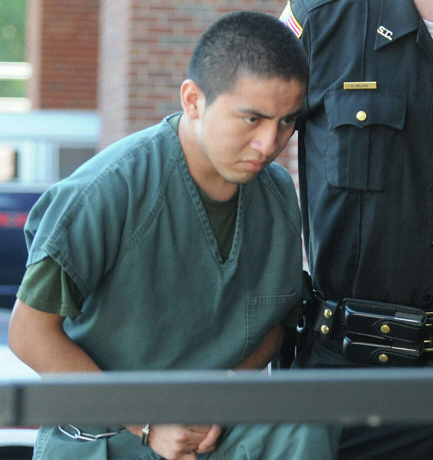 Antonio Lopez Bautista is led into  Saratoga County Courthouse on Wednesday, July 11,  2012 for his arraignment.  Bautista  allegedly attacked and attempted to kidnap a 67-year-old woman.  (Paul Buckowski / Times Union) Photo: Paul Buckowski / 00018417A