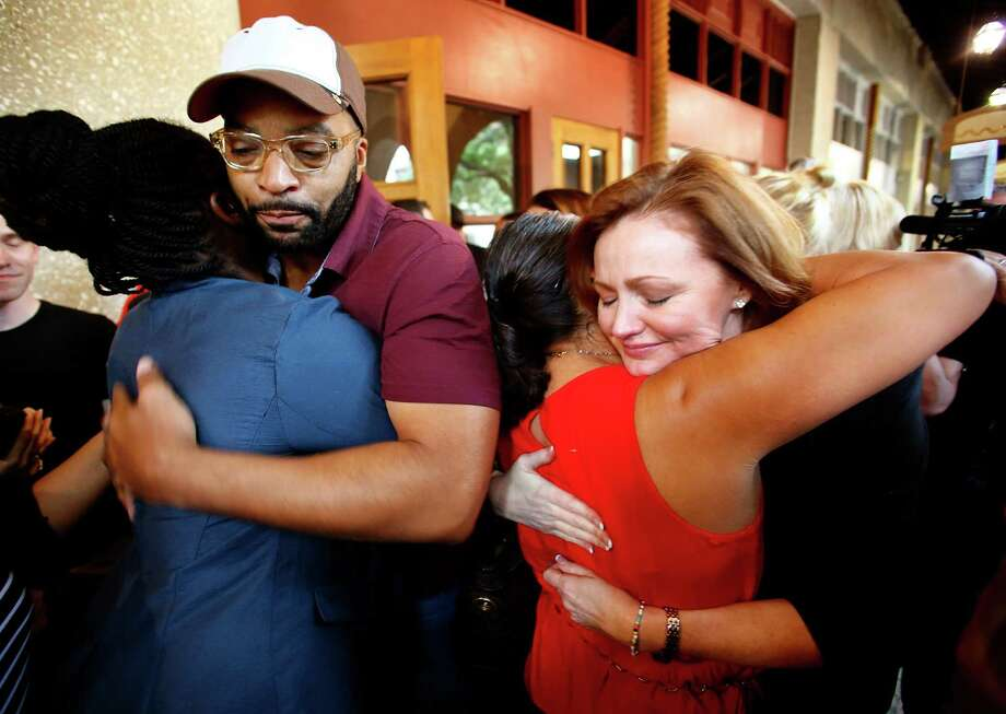 "KISS-FM radio personalities Kellie Rasberry, right, and Big Al Mack, left, take a break during their first broadcast since the passing of host David ""Kidd"" Kraddick to meet with their grieving fans, Monday, July 29, 2013, in Irving. Photo: Tom Fox, Associated Press / Dallas Morning News"