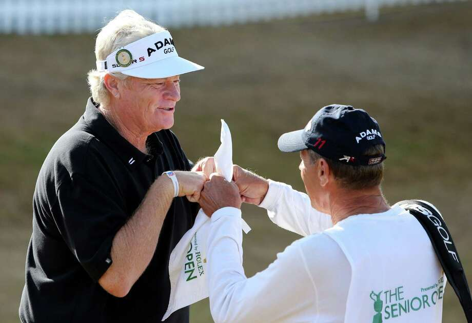 USA's Mark Wiebe celebrates winning the Senior Open Championship with a caddy at Royal Birkdale, Southport, England, Monday July 29, 2013. Mark Wiebe has won his first Senior Open Championship after he beat Bernhard Langer following five play-off holes at Royal Birkdale. (AP Photo/PA, Peter Byrne) UNITED KINGDOM OUT  NO SALES  NO ARCHIVE ORG XMIT: LON804 Photo: Peter Byrne / PA