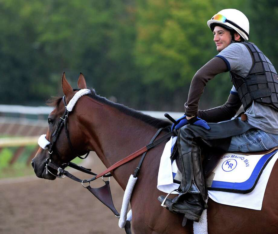 Exercise rider Nick Petro sits atop possible Whitney entrant Mucho Macho Man at the Saratoga Race Course July 29, 2013 in Saratoga Springs, N.Y.     (Skip Dickstein/Times Union) Photo: SKIP DICKSTEIN