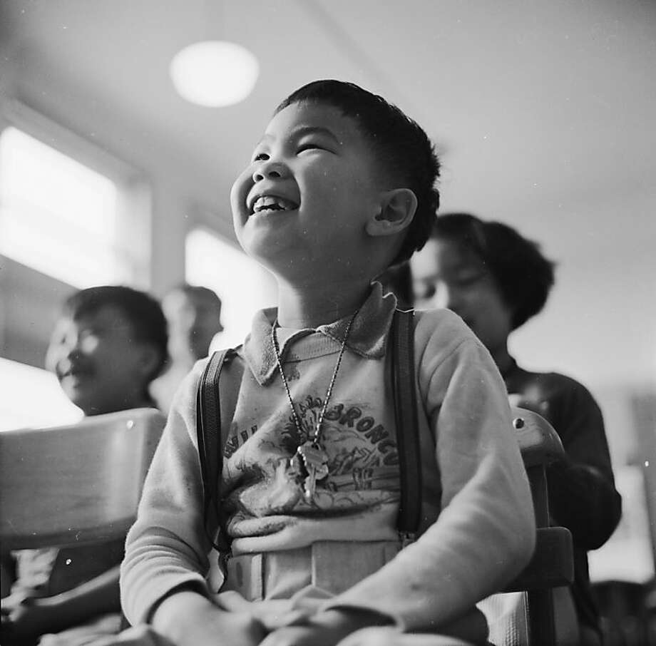 Circa 1955:  A little boy listens with rapt attention during a lesson at the Commodore Stockton School in Chinatown, San Francisco. The school provides education for most of Chinatown's younger children, and was named after Robert F Stockton, the first military governor of California.  Photo: Orlando, Getty Images