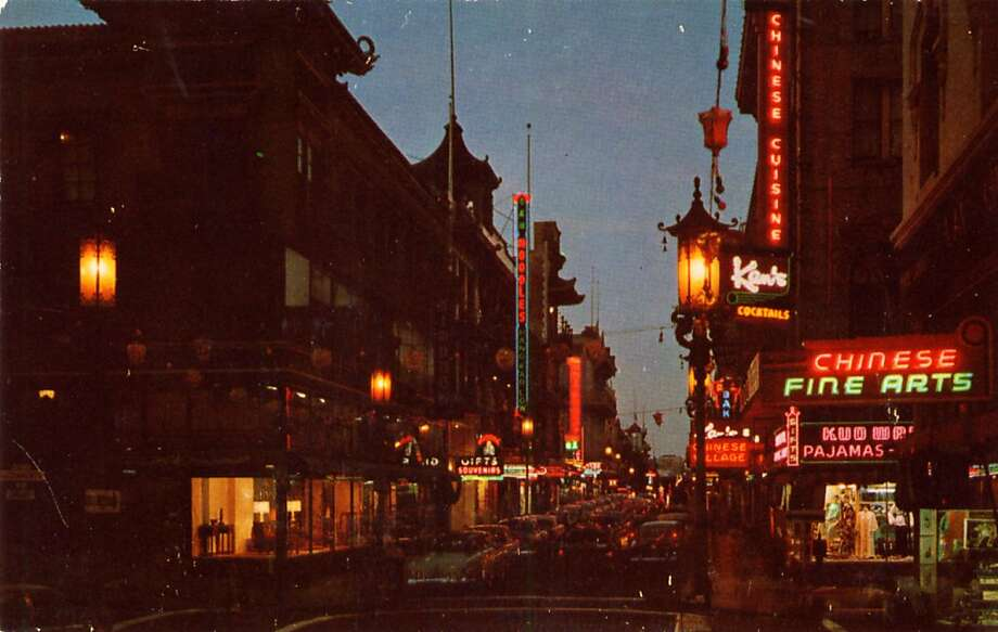 A night view of San Francisco's Chinatown in the 1950's. The streets are crowded with traffic and neon signs light up the night. Photo: Curt Teich Postcard Archives, Getty Images