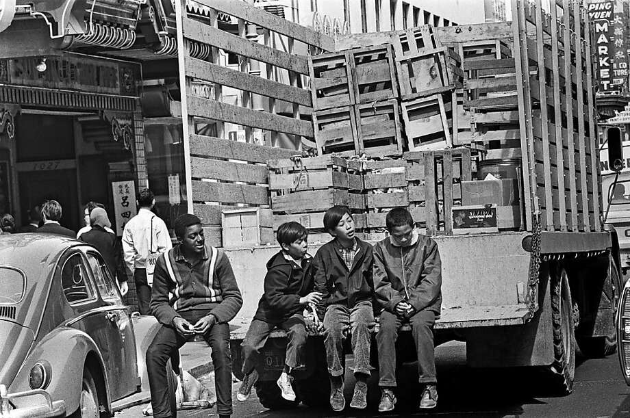Children while away the time on the back of a truck in Chinatown in early summer 1967. Photo: Michael Ochs Archives, Getty Images