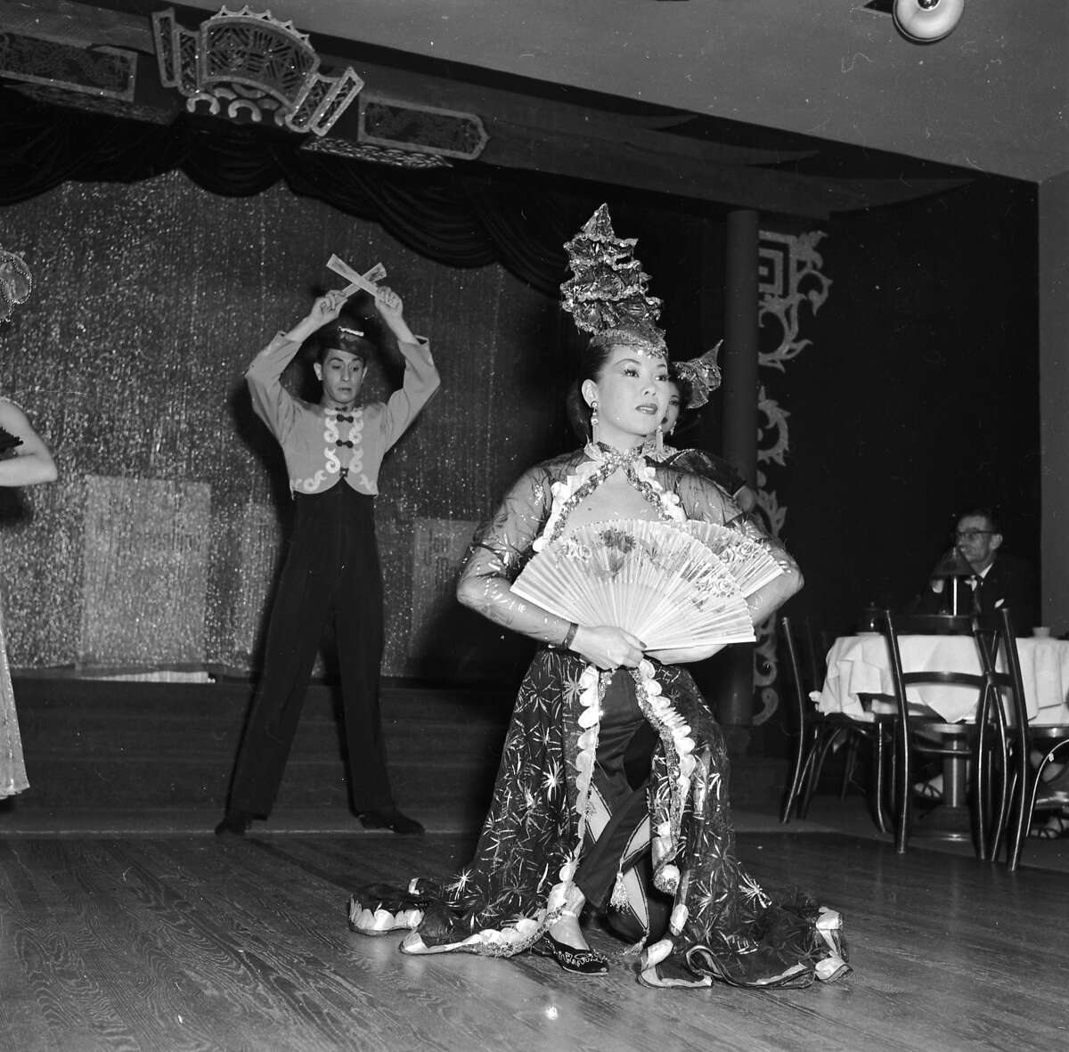 Circa 1955: Dancers Mae Tai Sing and Tony Wing perform an elaborate floor show at Forbidden City, a nightclub in Chinatown, San Francisco. (Photo by Orlando /Three Lions/Getty Images)
