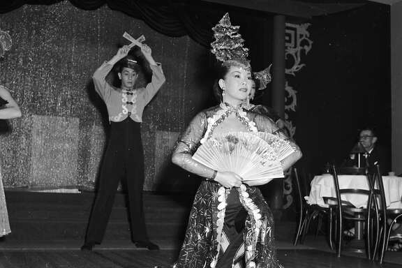 circa 1955:  Chinese dancers Mae Tai Sing and Tony Wing perform an elaborate floor show at Forbidden City, a nightclub in Chinatown, San Francisco.  (Photo by Orlando /Three Lions/Getty Images)