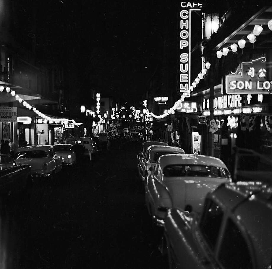 circa 1955:  At night, lanterns and neon lights advertise the Chinese restaurants along Grant Avenue in Chinatown, San Francisco.  Photo: Orlando, Getty Images