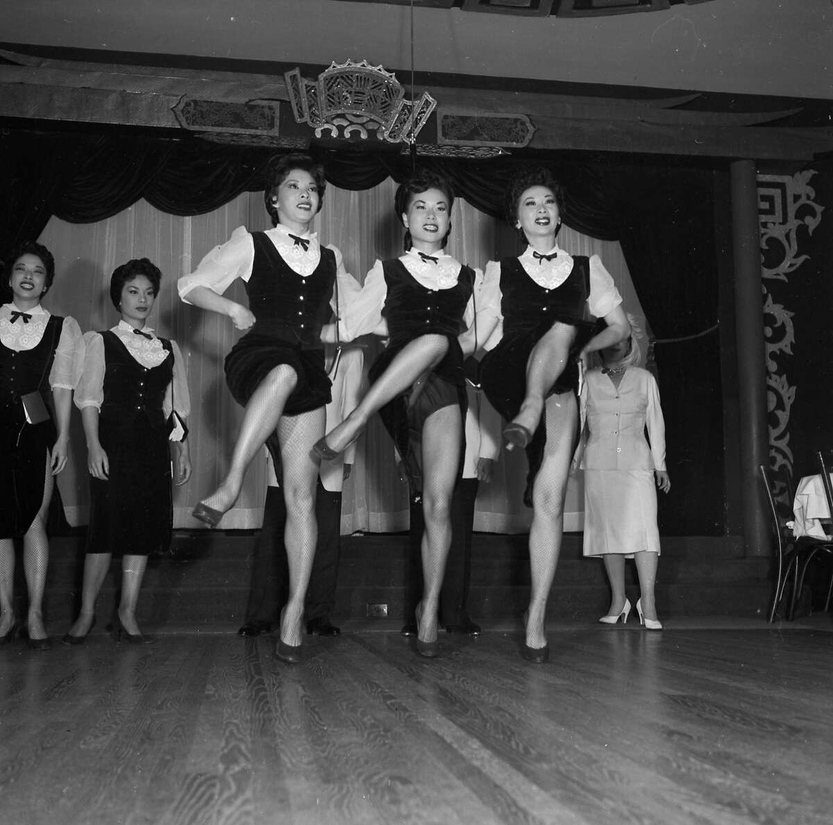 Circa 1955: A line of chorus girls entertains visitors to the Forbidden City nightclub in Chinatown, San Francisco. (Photo by Orlando /Three Lions/Getty Images)