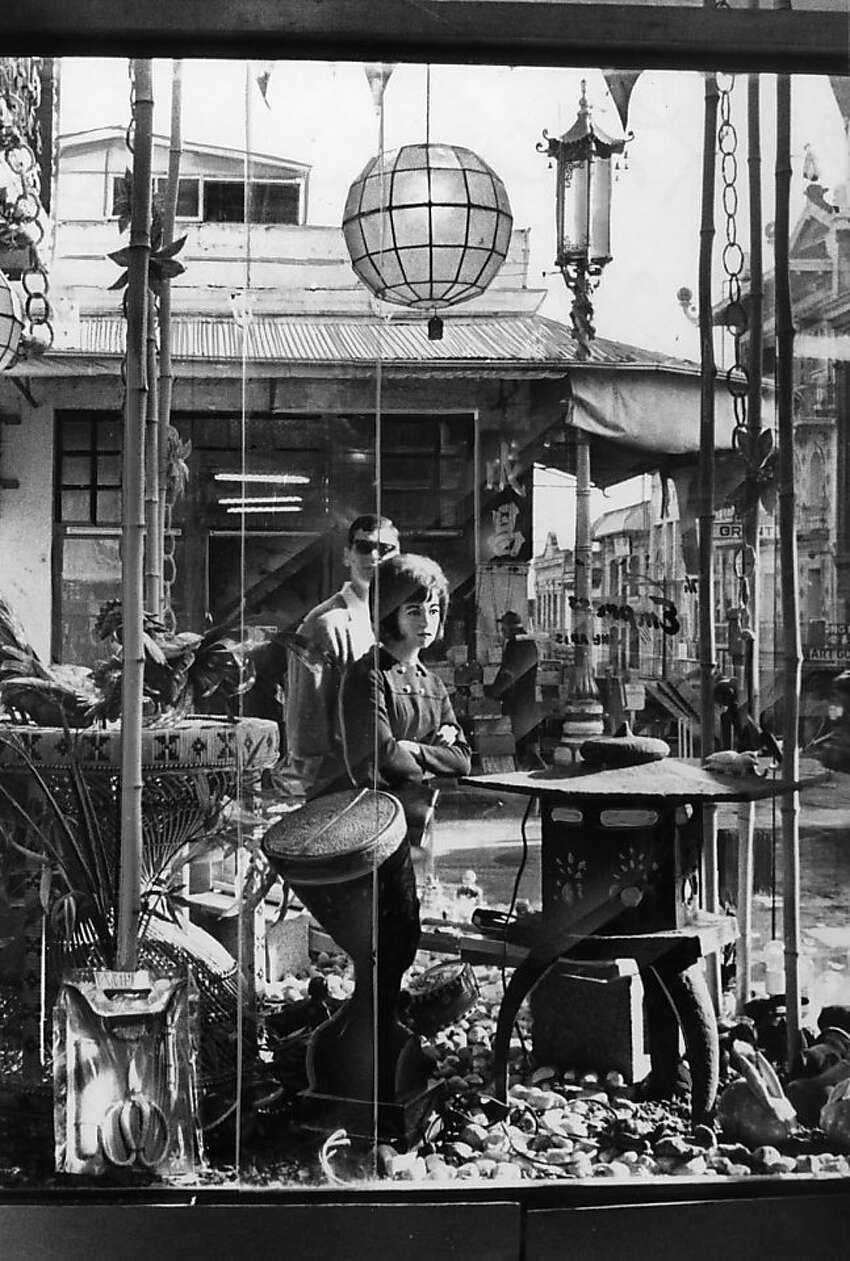 People look through a shop window on Grant Avenue in Chinatown in San Francisco on January 13, 1966.