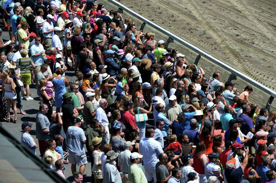 Crowds gather at the rail to watch the racing Monday afternoon, July 29, 201 3, at Saratoga Race Course in Saratoga Springs, N.Y. (Skip Dickstein/Times Union) Photo: SKIP DICKSTEIN / 00023334A