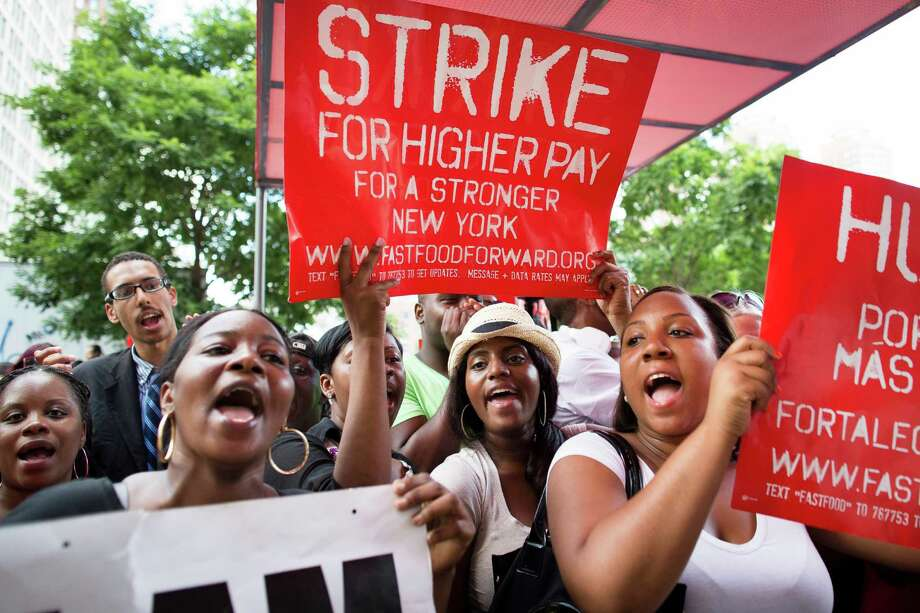 Demonstrators are calling for a higher wage for fast-food workers, but does the career make Americans better? See if your career makes the world better. Photo: John Minchillo, FRE / FR170537 AP