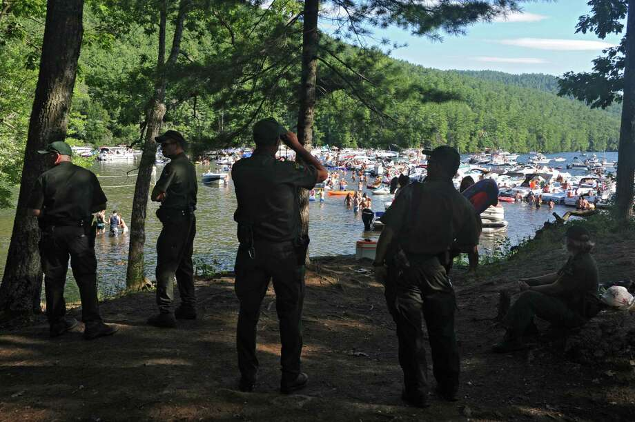 NYS Environmental Conservation forest rangers keep an eye on people celebrating Log Bay Day on their boats and in the water of Lake George Monday afternoon, July 29, 2013, in Fort Ann, N.Y. (Lori Van Buren / Times Union) Photo: Lori Van Buren / 00023226A