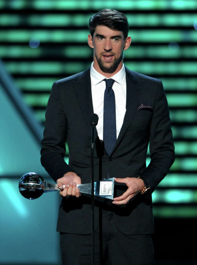 Michael Phelps accepts the award for best record-breaking performance at the ESPY Awards on Wednesday, July 17, 2013, at Nokia Theater in Los Angeles. (Photo by John Shearer/Invision/AP) ORG XMIT: CAPM238 Photo: John Shearer / Invision