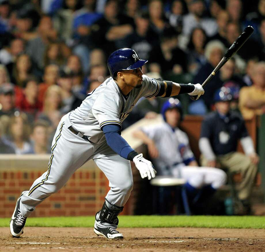 Milwaukee Brewers' Carlos Gomez singles in Jean Segura to score a run against the Chicago Cubs during the ninth inning of a baseball game, Monday, July 29, 2013, in Chicago. (AP Photo/Jim Prisching) ORG XMIT: CXC112 Photo: Jim Prisching / FR59933 AP