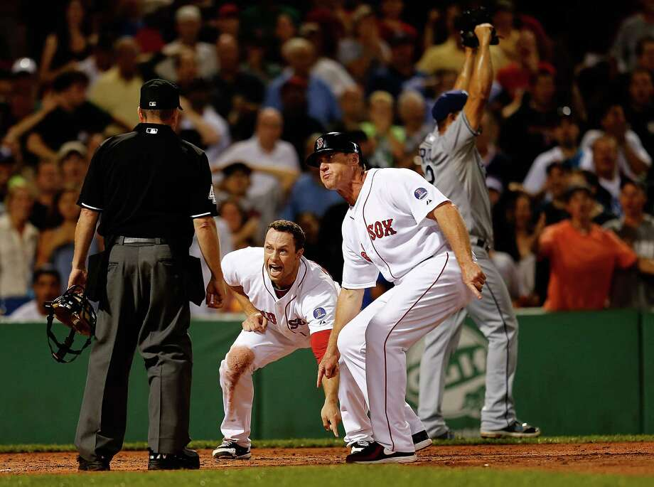 BOSTON, MA - JULY 29: Daniel Nava #29 and Brian Butterfield #13 of the Boston Red Sox plead their case after umpire Jerry Meals #41 called Nava out at the plate against the Tampa Bay Rays in the 8th inning at Fenway Park on July 29, 2013 in Boston, Massachusetts.  Nava run would have tied the game.(Photo by Jim Rogash/Getty Images) ORG XMIT: 175108998 Photo: Jim Rogash / 2013 Getty Images