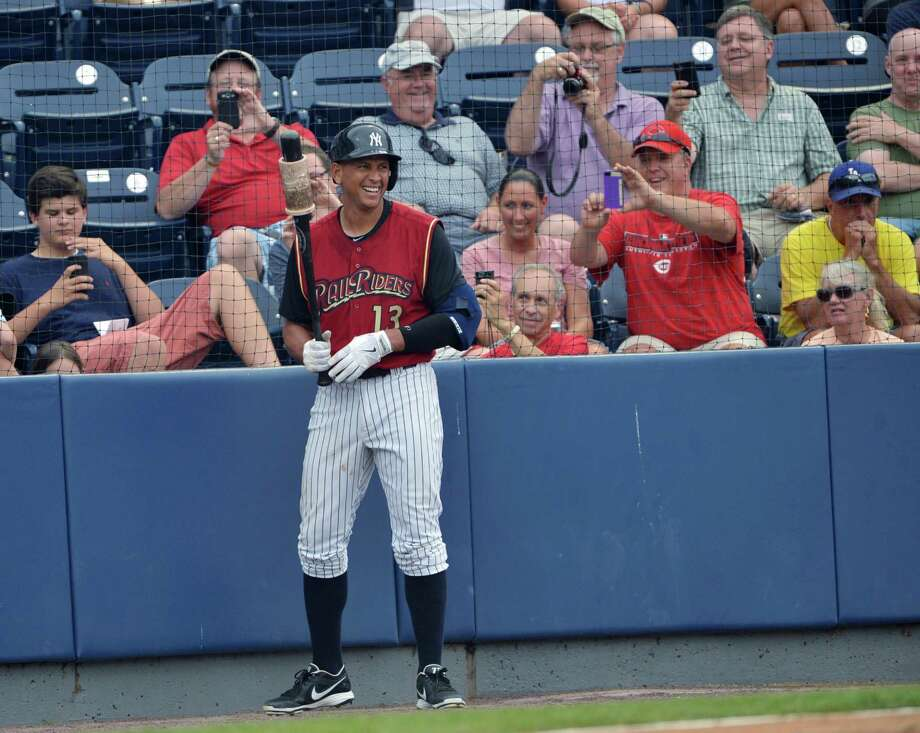 New York Yankees' Alex Rodriguez smiles as fans take photos as he prepares to bat during a rehab assignment with the Scranton/Wilkes-Barre RailRiders, against the Louisville Bats in a baseball game Thursday, July 18, 2013, in Moosic, Pa. (AP Photo/The Scranton Times-Tribune, Jason Farmer) WILKES-BARRE TIMES-LEADER OUT ORG XMIT: PASCR301 Photo: Jason Farmer / The Scranton Times-Tribune