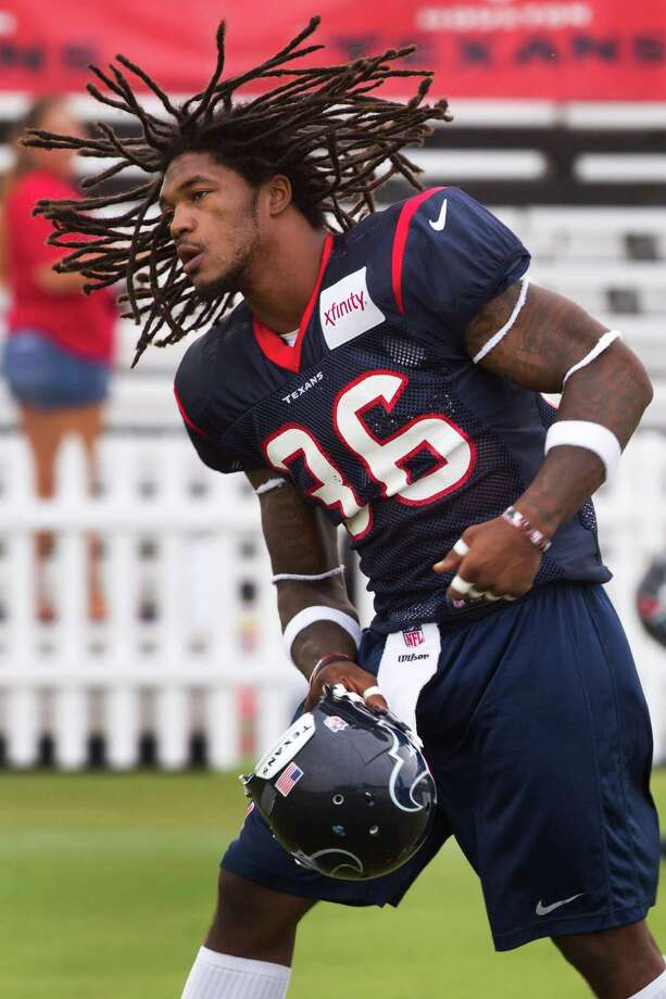 Rookie safety D.J. Swearinger is standing out in the early days of camp for more than his hairstyle. Photo: Brett Coomer, Staff / © 2013 Houston Chronicle