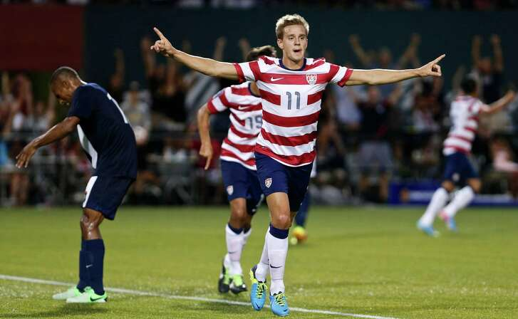 FILE - In this July 9, 2013, file photo, the United States' Stuart Holden celebrates his second half goal against Belize during a CONCACAF Gold Cup soccer match at Jeld-Wen Field in Portland, Ore. The U.S. midfielder, who has fought a severe knee injury for two and a half years, finally got in a full 90 minutes for the first time since September 2011 when the United States beat Costa Rica 1-0 in a Gold Cup match on  July 16. (AP Photo/The Oregonian, Thomas Boyd, File) MAGS OUT; TV OUT; LOCAL TV OUT; LOCAL INTERNET OUT; THE MERCURY OUT; WILLAMETTE WEEK OUT; PAMPLIN MEDIA GROUP OUT