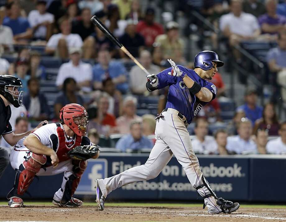Carlos Gonzalez went 5-for-5 with two RBIs after missing the previous three games with a sprained middle right finger in the Rockies' 9-8, 10-inning loss in Atlanta on Monday night. Photo: John Bazemore, Associated Press