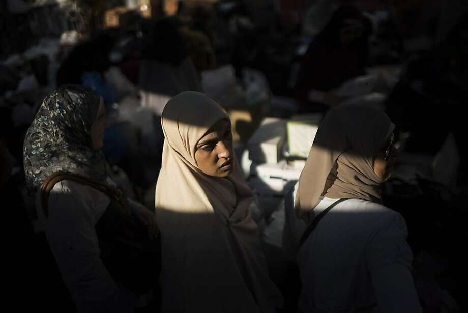 A supporter of Egypt's ousted President Mohammed Morsi stands in a makeshift warehouse for medical supplies at Nasr City, where protesters have installed a camp and hold daily rallies, in Cairo, Egypt, Monday, July 29, 2013.  Europe's top diplomat urged Egypt's government to reach out to the Muslim Brotherhood as she worked Monday to mediate an end to the country's increasingly bloody crisis, while the mainly Islamist protesters calling for the return of ousted leader Mohammed Morsi massed for more protests. (AP Photo/Manu Brabo) Photo: Manu Brabo, Associated Press