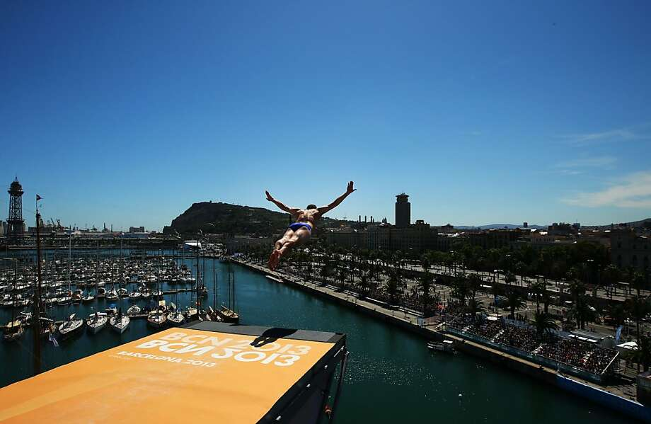 BARCELONA, SPAIN - JULY 29:  Kent De Mond of the USA competes during the Men's 27m High Diving on day ten of the 15th FINA World Championships at Moll de la Fusta on July 29, 2013 in Barcelona, Spain.  (Photo by Al Bello/Getty Images) *** BESTPIX *** Photo: Al Bello, Getty Images