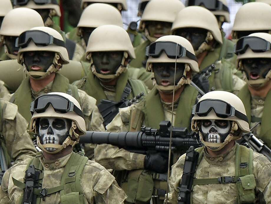 Peruvian Army special forces march during a traditional military parade in Lima on July 29, 2013 commemorating the country's 192nd independence anniversary.     TOPSHOTS/AFP PHOTO/CRIS BOURONCLECRIS BOURONCLE/AFP/Getty Images Photo: Cris Bouroncle, AFP/Getty Images