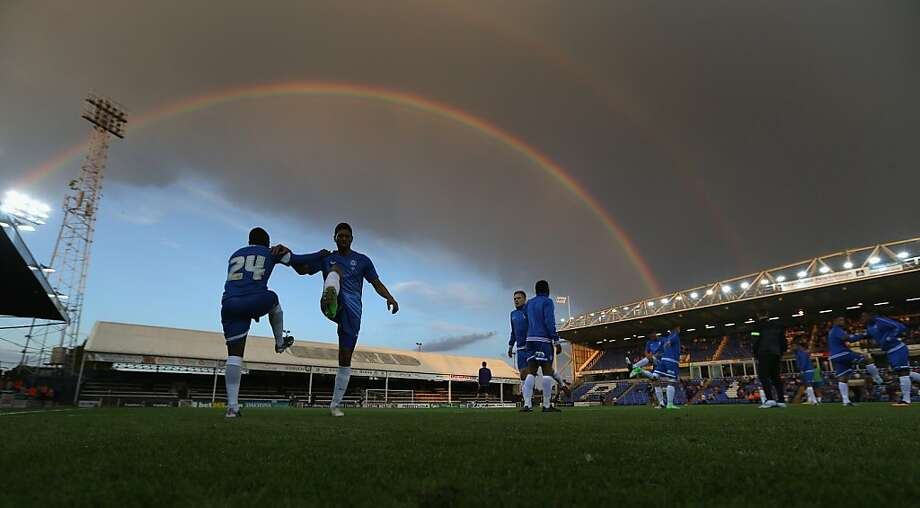 PETERBOROUGH, ENGLAND - JULY 29:  Peterborough United players warm up at half time underneath a rainbow during the pre season friendly match between Peterborough United and Hull City at London Road Stadium on July 29, 2013 in Peterborough, England.  (Photo by David Rogers/Getty Images) *** BESTPIX *** Photo: David Rogers, Getty Images