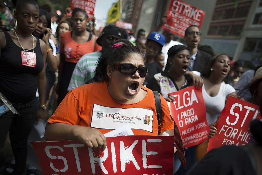 Demonstrators in support of fast food workers march towards a McDonald's as they demand higher wages and the right to form a union without retaliation, Monday, July 29, 2013, in New York's Union Square. The national Fast Food Forward campaign is organizing the demonstrations. Strikes are planned in other cities this week. (AP Photo/John Minchillo) Photo: John Minchillo, Associated Press