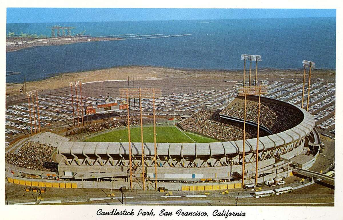 Vintage postcard showing a bird's eye view of Candlestick Park and the surrounding parking area. San Francisco Bay is in the distance. (Photo by Lake County Museum/Getty Images)