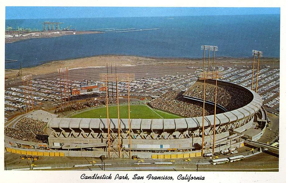 Vintage postcard showing a bird's eye view of Candlestick Park and the surrounding parking area. San Francisco Bay is in the distance. Photo: Curt Teich Postcard Archives