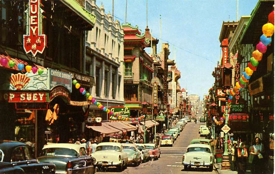 Vintage 1957 postcard showing a view down Grant Ave. in San Francisco's Chinatown, the sidewalks are teeming with pedestrians and vintage automobiles line the street. Photo: Curt Teich Postcard Archives, Getty Images