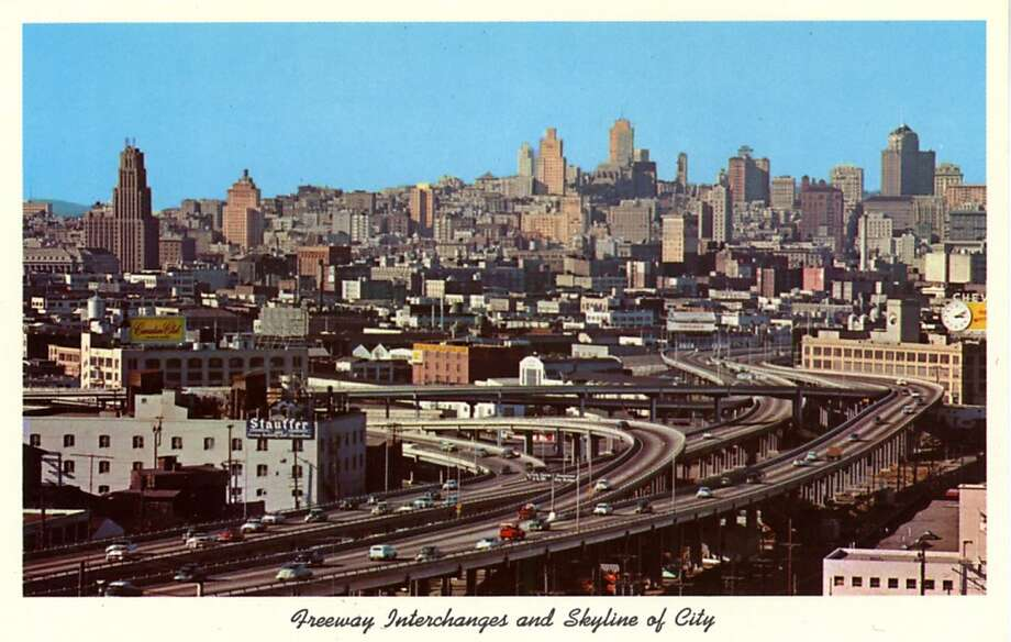 Vintage postcard showing a bird's eye view of the freeway interchanges and skyline of the city. Photo: Curt Teich Postcard Archives