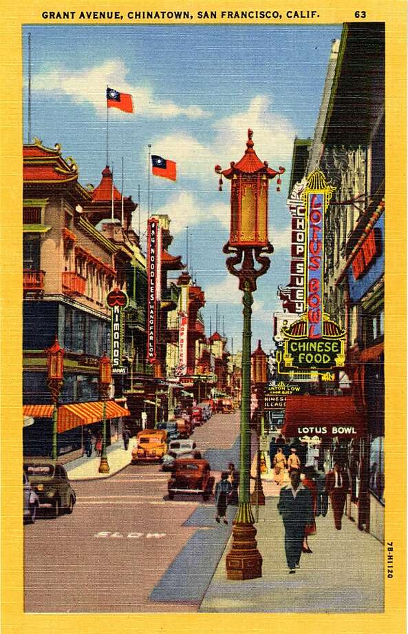 Vintage linen postcard showing a view down Grant Street in San Francisco's Chinatown. The neon sign for the Lotus bowl restaurant is visible on the rights. Vintage automobiles are on the street and pedestrians are walking along the sidewalks. Oriental style architecture is very prominent.  Photo: Curt Teich Postcard Archives