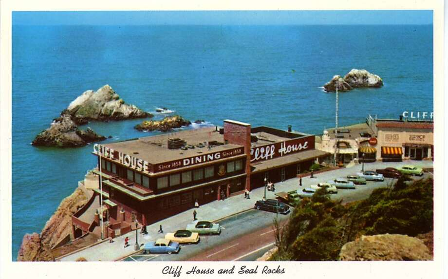 Vintage postcard showing a bird's eye view of th the Cliff House and Seal Rocks. The view looks down onto the restaurant and parking lot and out over the Pacific Ocean. Photo: Curt Teich Postcard Archives
