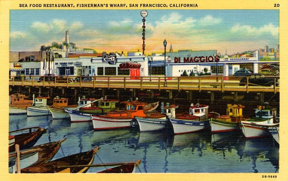 Vintage 1940 linen postcard showing Joe DiMaggio's restaurant across the inlet on the Wharf, fishing boats are tied to the docks. Photo: Curt Teich Postcard Archives, Getty Images