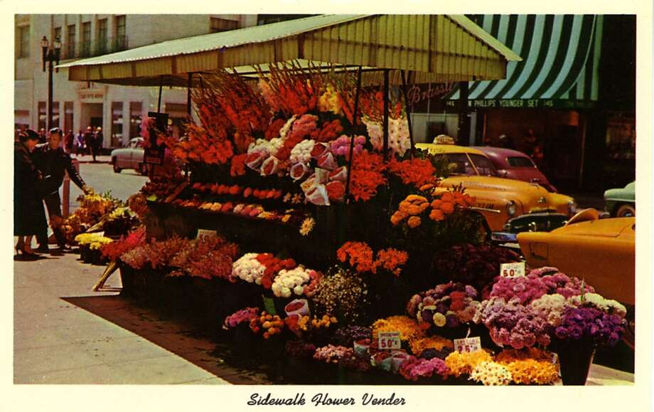 Vintage postcard showing a flower vendors stall set up on the corner of a busy street in San Francisco. Photo: Curt Teich Postcard Archives