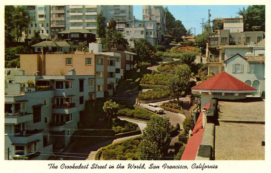 Vintage postcard view of Lombard Street with its serpentine turns. View shows the landscaping along the route and the houses that line the street. Photo: Curt Teich Postcard Archives