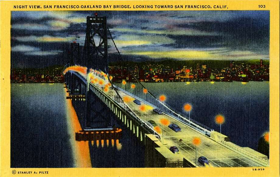 1945  Postcard view of the San Francisco-Oakland Bay Bridge at night showing the San Francisco Skyline. Photo: Curt Teich Postcard Archives, Getty Images