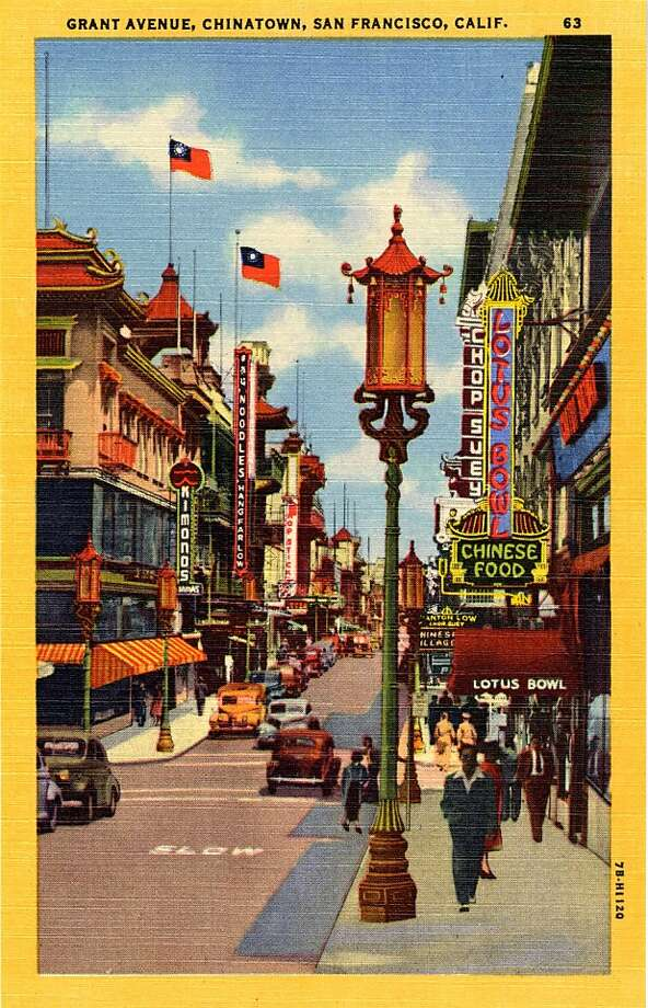 Vintage linen postcard from 1947 showing a view down Grant Street in San Francisco's Chinatown, the neon sign for the Lotus bowl restaurant is visible on the rights. Vintage automoiles are on the street and perdetrians are walking along the sidewalks. Oriental style architecture is very prominent. Photo: Curt Teich Postcard Archives, Getty Images