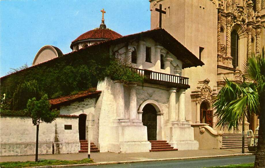 Vintage postcard showing the exterior of Mission Dolores with its red tiled roofs and its exterior partially covered with greenery. Photo: Curt Teich Postcard Archives