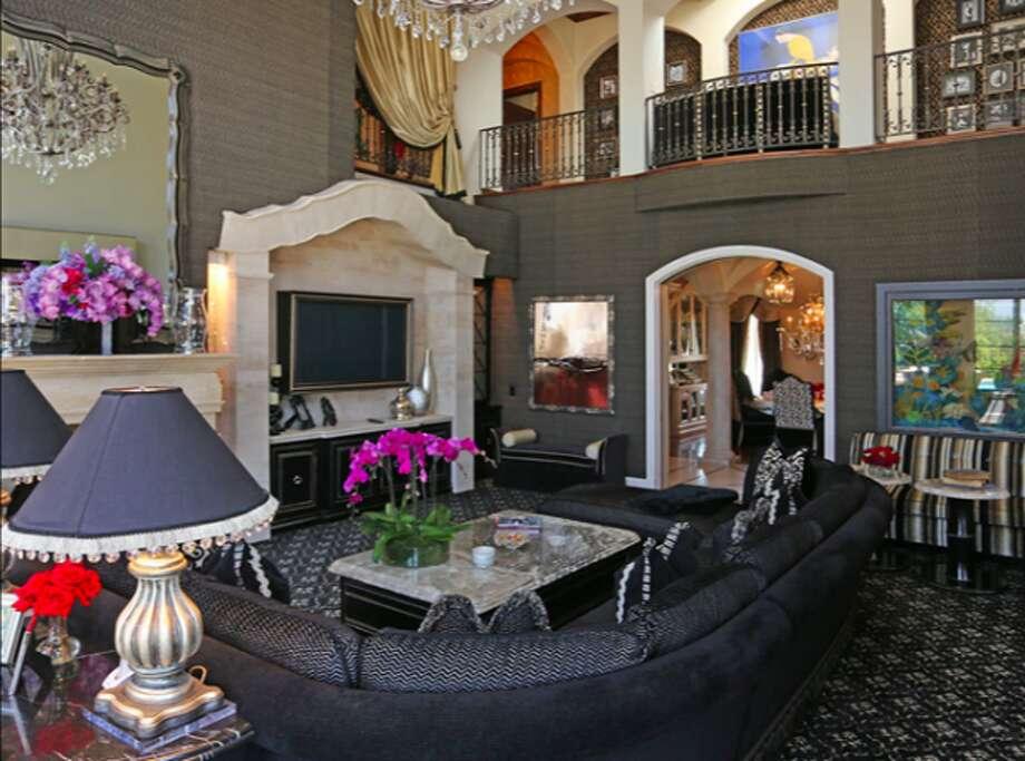 Strange 2-story living room.  Photos via Trulia Luxe.