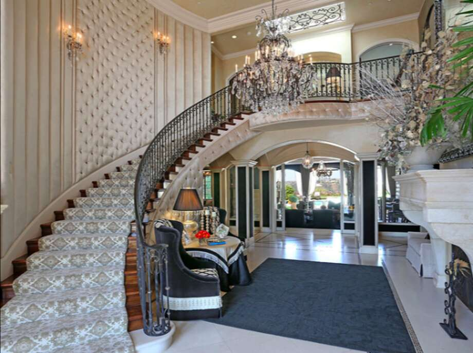 Swirling stairway ala Gone with the Wind or Liberace.  Photos via Trulia Luxe.