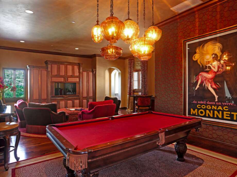 Game room, red pool table in a nod to coolness.  Photos via Trulia Luxe.