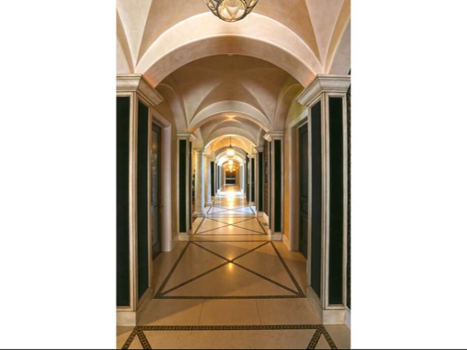 Hallway showcasing the many doorways available.  Photos via Trulia Luxe.