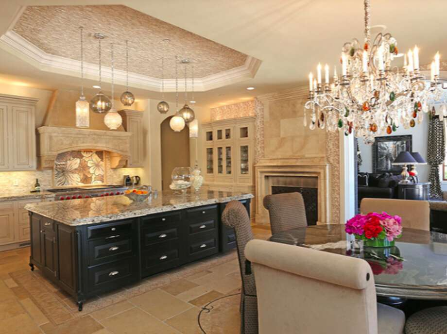Kitchen and dining area with jewel encrusted chandelier.  Photos via Trulia Luxe.