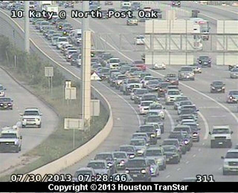 A 5-car pileup slows eastbound Katy Freeway near N. Post Oak Tuesday morning. Photo: Houston TranStar