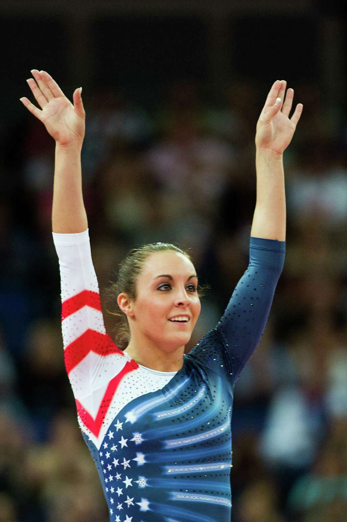 Savannah Vinsant waves to the crowd after competing in women's trampoline at the 2012 London Olympics on Saturday, Aug. 4, 2012. ( Smiley N. Pool / Houston Chronicle )