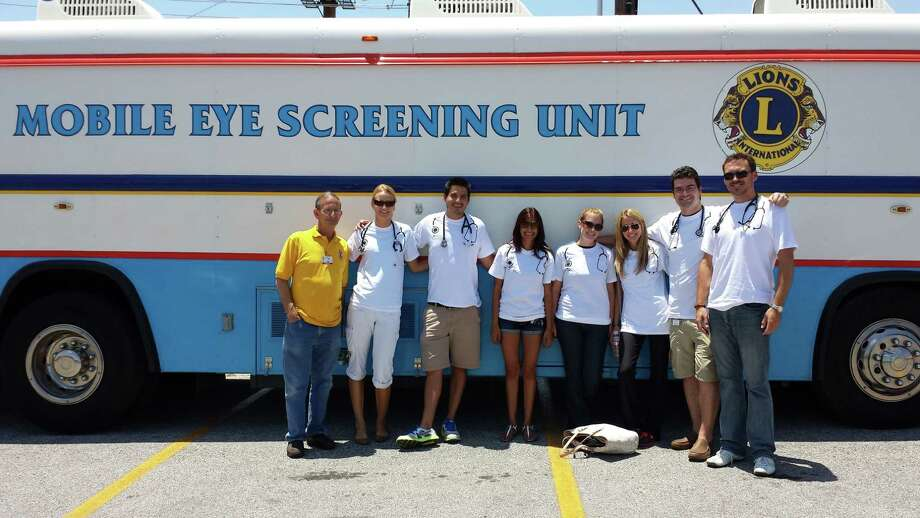From left, Chris Lloyd, unit manager, and medical students Lisa Vogel, Luke Berry, Alyssa Esmail, Kat Eurich, Angeline Mariani, Mike Canepa and Gavin Best manned the District 2-A2 International Association of Lions Clubs Mobile Eye Screening Unit. Photo: Courtesy Photo