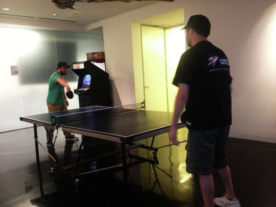 Geekdom's ping pong table helps tech start-up workers blow off steam at the office.  Photo: Sarah Tressler/San Antonio Express-News